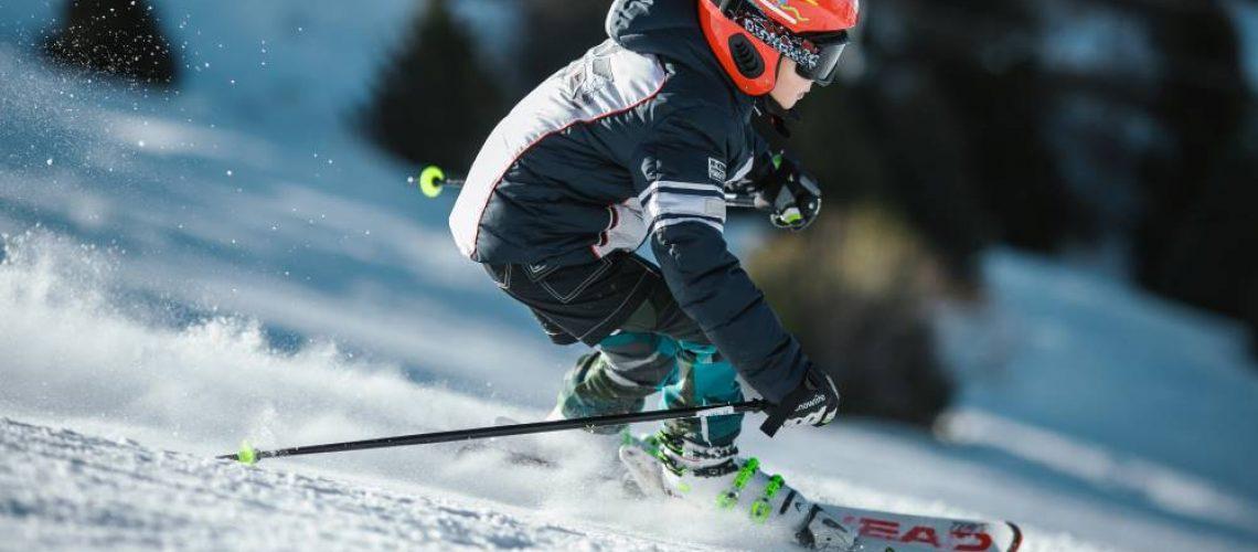 Man Doing Ice Skiing on Snow Field